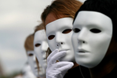 Actors wearing theatrical masks.